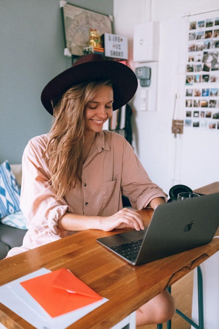 smiling-woman-using-laptop-3277920